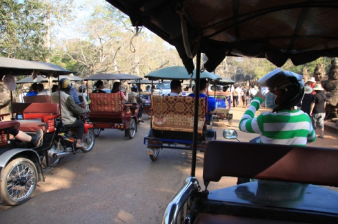Tuktuks heading to Angkor Wat