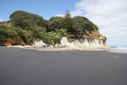 Waiiti beach and bach on the cliff
